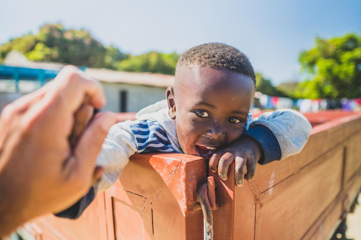 Praying with a street boy in Zambia